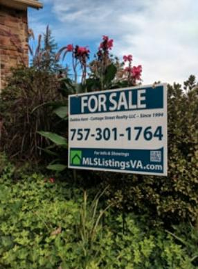 FSBO MLS listing basic yard sign installed in a garden