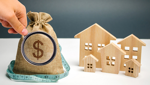 ag of money, tape measure and wooden model of mls listing by owner homes for sale